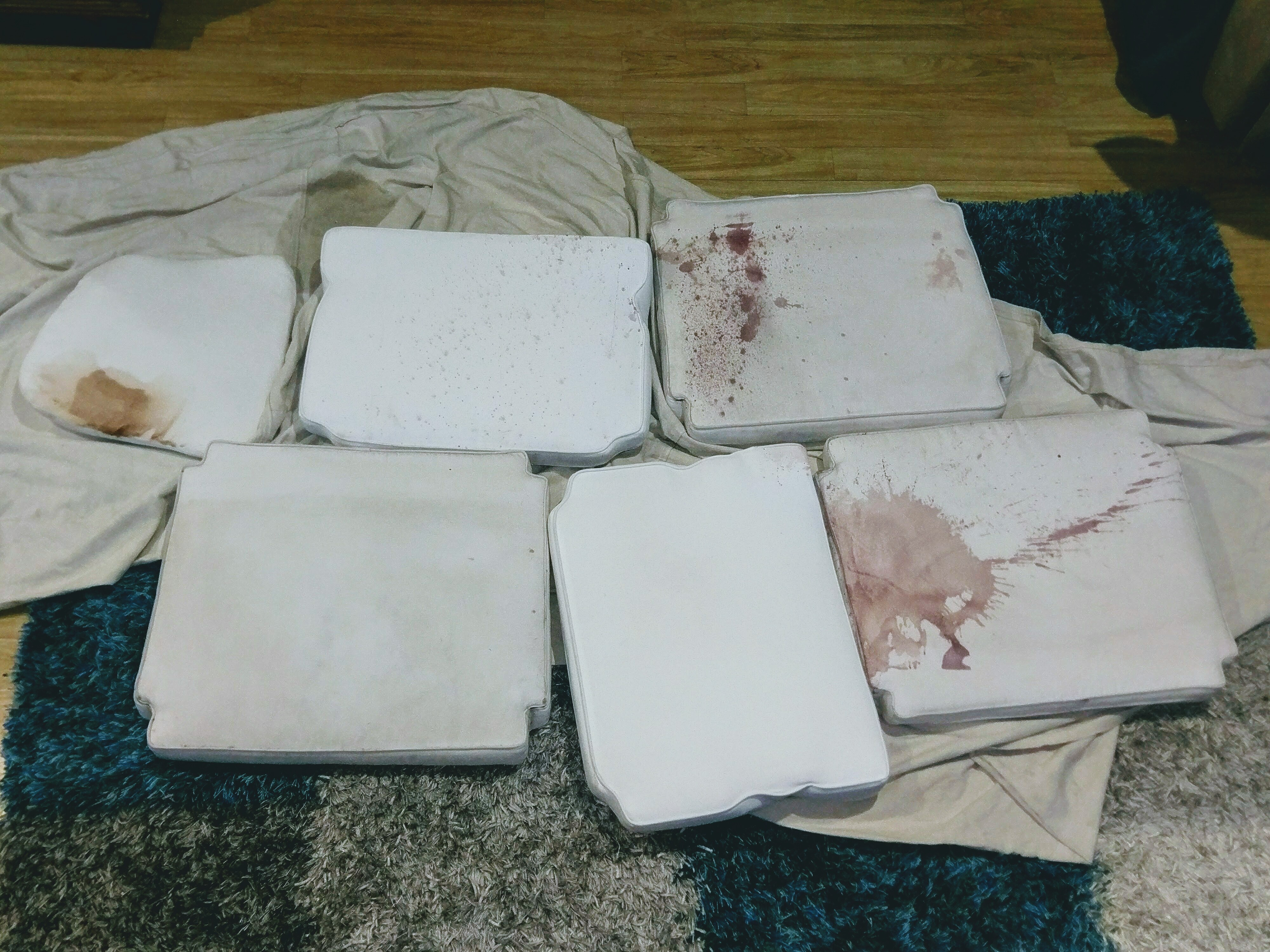 Red wine spill on white sofa